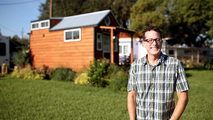 The charismatic tiny house advocate James Taylor in front of his home, The Company Store on Wheels