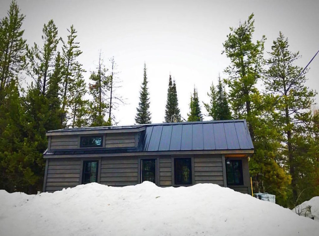 Ariel keeps her tiny house cozy in the Wyoming mountains - click to watch tour!