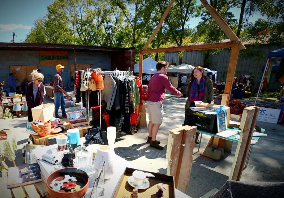 our flea market booth where we sold our downsized belongings to make money for our tiny house build