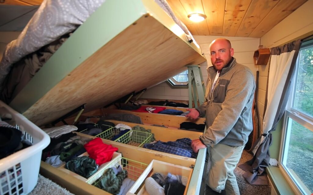 under the bed clothing storage - click to watch tiny house tour!