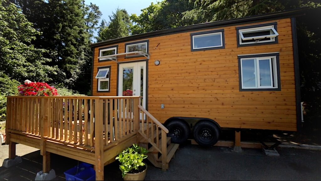 a tiny home with multiple kinds of windows - click to watch the TOUR!